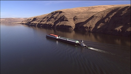 (Idaho Public Television) Barges take goods from Idaho's Port of Lewiston to the Pacific Ocean. Sediment is building up behind the lower Snake River's Lower Granite Dam, making travel more difficult.