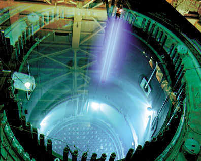 After six years of service in Columbia Generating Station's reactor, nuclear fuel rods are moved to a holding pool prior to be loaded into steel and concrete storage casks. The fuel still retains 95 percent or more of its energy after six years.