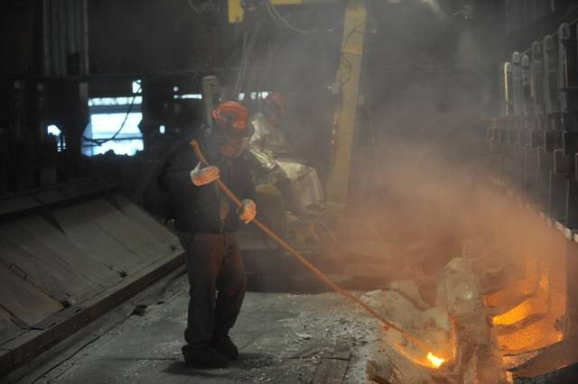 Workers start aluminum smelter pots on potline B at the Alcoa Intalco aluminum smelter west of Ferndale on Feb. 15, 2011. Though Alcoa plans to idle the plant June 30, 2016, the company is hiring temporary workers to help ensure the facility is adequately staffed.  (Philip A. Dwyer photo)