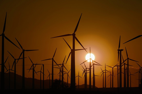 Strong winds power giant turbines in Palm Springs, Calif., on Wednesday. Mandates for utilities passed by states have fueled a big expansion of wind and solar capacity in recent years.