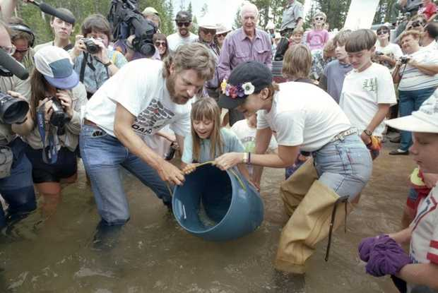 Charles Ray of McCall, left, and actress Jamie Lee Curtis join Allyson Coonts, center, in releasing sockeye into Redfish Lake on Aug. 12, 1993. Gov. Cecil Andrus is behind them. RedFish BlueFish videographer Arianne Russell left of Charles Ray.