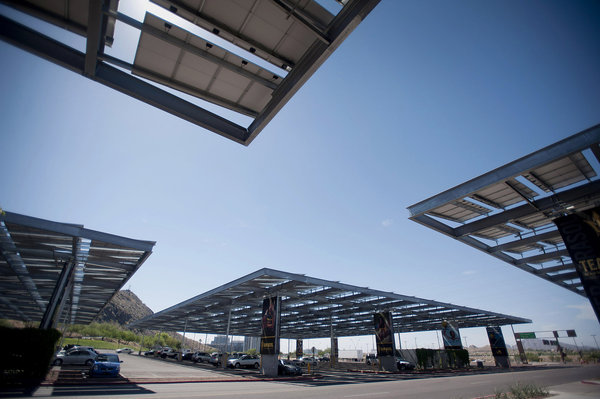 Solar panels stand above a parking lot at Arizona State University in Tempe (Laura Segall photo)