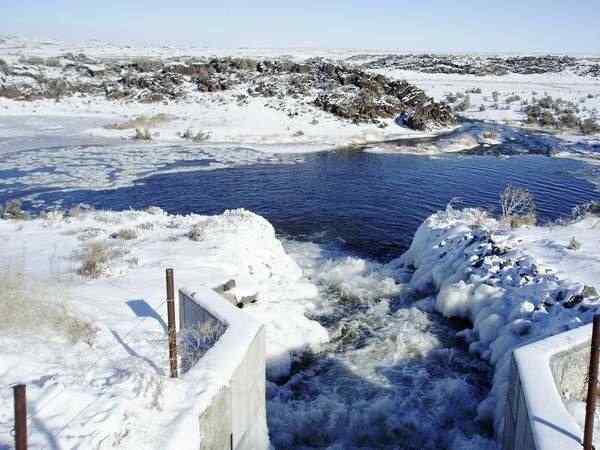 Winter aquifer recharge is conducted recently at American Falls Reservoir District No. 2's Milepost 31 recharge site. A work group has been assigned to draft a bill for the Idaho Legislature to implement an aquifer recharge credit system for the Eastern Snake Plain.