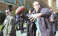 Democratic Presidential Canditate Bill Bradley shows off his throwing arm Thursday while touring the University of Washington campus in Seattle