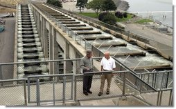 President George W. Bush talks with Witt Anderson during a tour of the Ice Harbor Lock and Dam in Burbank, Wash., Friday,August 22, 2003. White House photo by Paul Morse.