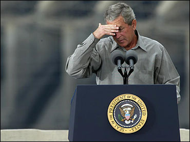 (Photo:AP Ted S. Warren)President Bush wipes his brow during an environmental address at the Ice Harbor Lock and Dam near Burbank, Wash., Friday, Aug. 22.