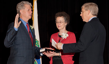 Bill Drummond (left), accompanied by his wife, Elizabeth, takes the oath of office, which was administered by Department of Energy Deputy Secretary Daniel Poneman.