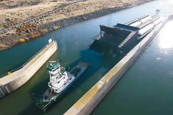 (Andy Porter/Union Bulletin) A 1,000-ton removable fish weir is guided into the navigation lock at Lower Monumental Dam late Tuesday afternoon. The weir arrived from Portland and will be installed in coming days.