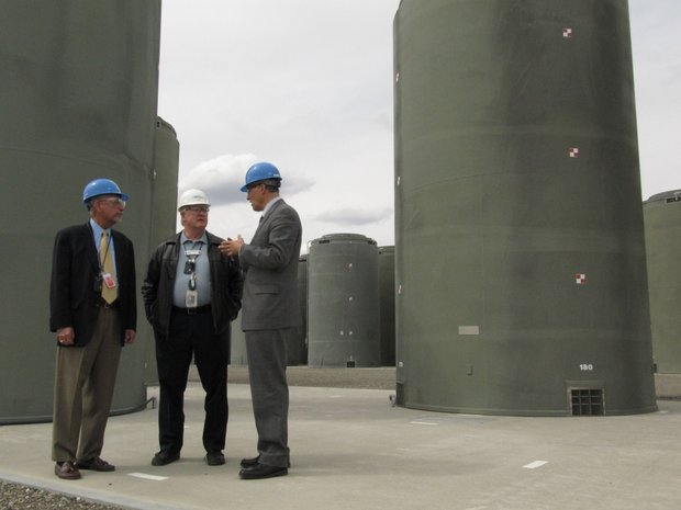 Energy Northwest CEO Vic Parrish, center, shows U.S. Reps. Doc Hastings, left, and Jay Inslee containers holding spent nuclear fuel from the Northwest's only commercial nuclear plant Friday in Richland.