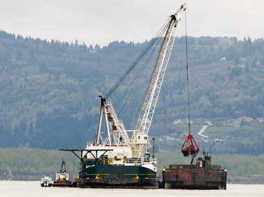 (Brent Wojahn) Back in March, a dredge near Longview, Wash., finished up some of the final work on the 20-year Columbia River dredging project. Officials from Oregon and Washington celebrated the completion of the project Thursday in Vancouver, Wash.