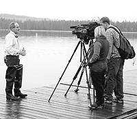 (Photo David N. Seelig) Idaho Gov. Jim Risch speaks with media representatives Friday at Redfish Lake near Stanley, where he helped release sockeye salmon in an effort to sustain the species' continued survival.