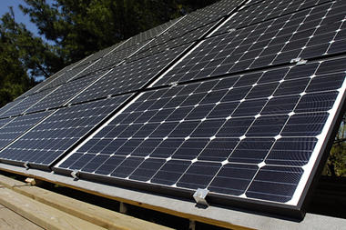 (Andy Lavalley/The Post-Trubune) Some of the twenty 3 by 5 foot solar panels recently installed by Rich Herr at his home in Valparaiso, Ind. Solar power could disrupt the business model of traditional utility companies.