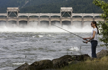 (Doug Beghtel) Ashley Soto of Albany fishes below Bonneville Dam during the high spring river flow.