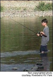 Young camper fishs the Twisp River.