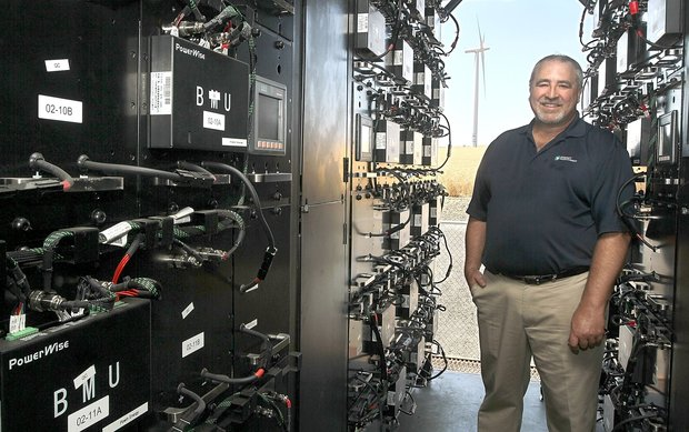 (Bob Brawdy photo)John Steigers, a project developer for Energy Northwest, stands inside a portable shipping container filled with batteries that are part of an intelligent storage system currently being tested at the Nine Canyon Wind Project south of Kennewick.