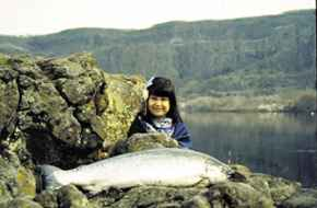 Aurora Matta, Yakama, with a salmon, along the Columbia River.